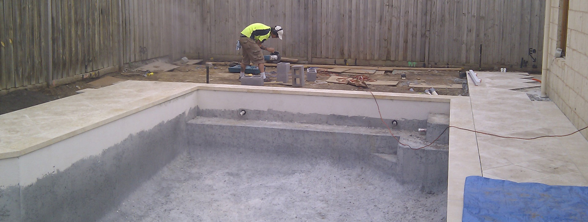 tiling the waterline of a swimming pool