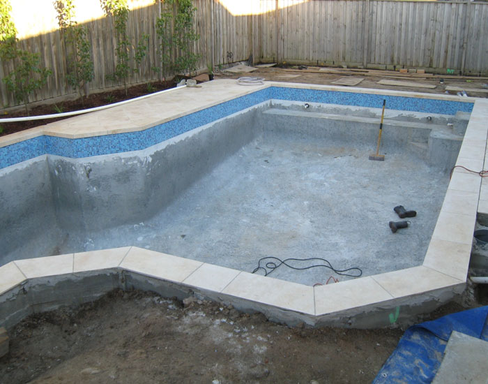 tiling the waterline of the pool
